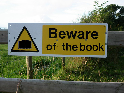 Beware of the book sign