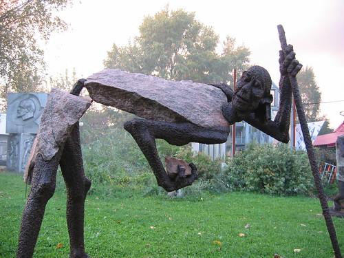Bent statue.