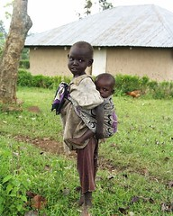 'He ain't heavy, he's my brother!' (rogiro) Tags: africa girls baby love boys freeassociation girl wearing sisters john town is bill olivia kenya sister brother father neil philosophy christian diamond vietnam story upper babywearing afrika caring care he heavy hes aint roe carrier carry newton carrying flanagan medley upcountry boma hollies bomas fulkerson heaintheavyhesmybrother mrthehollies
