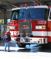 Little boy, big truck (OldOnliner) Tags: november rescue wisconsin firetruck fireman firefighting firestation firefighter firedepartment iwant5 beloit anythingfantastic 2006calendarsamplea calendarphoto cotcbest2005 utatafeature