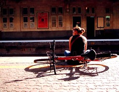 Free-Wheeling.... (Trapac) Tags: light shadow red england woman bicycle bristol geotagged platform railwaystation cycle blogged seated lightshadow bristoltemplemeads geo:lat=51449728 explored geo:lon=258007 flickl2 thebristolchain bloggedwithlink blognotinformed