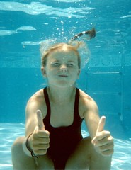 underwater girl giving a big thumbs up