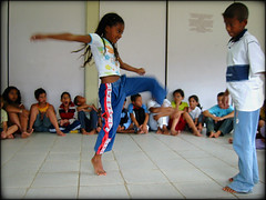 Shy are we? (carf) Tags: poverty girls brazil boys sport brasil kids youth children hope kid community education support capoeira child hummingbird culture esperança social impoverished underprivileged afrobrazilian altruism entrepreneurship shanty educational capoeirabeijaflor beijaflor favela development investment prevention larmariaesininha morrodomacaco