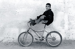Kid on his bike - Qalandiya Camp (velvetart) Tags: qalandiya refugee camp palestine israel blackandwhite bw bicycle kid tongue forsakenpeople globalpoverty