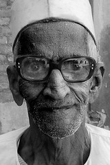 thick glass (puja) Tags: portrait blackandwhite bw india man topf25 face glasses topf50 yes indian headshot tenpositive