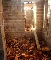 Max in the hallway at 12 weeks showing the 50cms of rock base for the straw bales (hardworkinghippy) Tags: trees house france building architecture grid solar energy natural selfbuild insulation off led organic build buildingahouse hardwork cabane renewable windpower solarpower solaire newbuild offgrid autoconstruction panneauxsolaires bourrou hardworkinghippy ecoconstruction bioclimatique offgridhouse selfsufficientcy strawbaleinsulation autoconstruct smallholdingoffgrid insulatingwithstraw selfbuildstonehouse