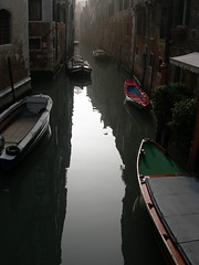 the red boat (birdcage) Tags: venice italy canal boats redboat reflection foggy