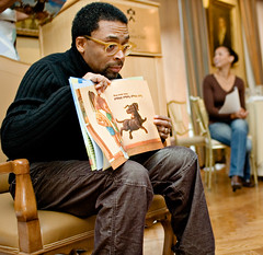 "Books for Kids: Spike Lee demonstrates ""Please, Puppy, Please!"" (Ryan Brenizer) Tags: 2005 nyc newyorkcity november man celebrity topf25 work book nikon manhattan flash d70s photojournalism sigma30mmf14dc princetonclub spikelee sigma30mmf14exdchsm booksforkids"