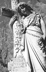 Woman with cross (kristindale) Tags: monument cemetery cemeteries death dying grieving cross grave