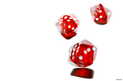 are you a high roller? (e X i t 1 3 p h o t o g r a p h y) Tags: red dice motion catchycolors movement topf50 roll gamble threeofakind