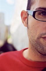 on my desk (seventytw0dpi) Tags: yuval stubble glasses dof red love eye topv111