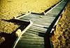 walk way (lomokev) Tags: wood lomo lca xpro lomography crossprocessed xprocess madera stones ground lomolca dungeness agfa holz jessops100asaslidefilm agfaprecisa lomograph agfaprecisa100 cruzando precisa filelomo0905a27 jessopsslidefilm ξυλο