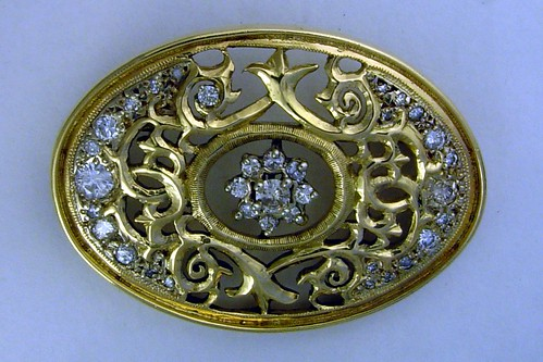 Diamond, florentine oval broche, gold by Somma.