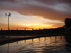 Sunset in the swimmingpool (marlenells) Tags: sunset sky topf25 water silhouette topc25 topv111 clouds reflections wonderful wonder topv555 topv333 awesome topc50 topc75 100v10f topc100 swimmingpool 2550fav topv777 zoomzoom railings 1000v i500 p1f1