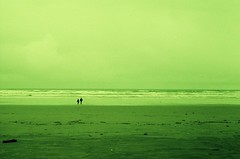 distant couple in green (travis ezell) Tags: sky green film beach horizontal 35mm coast couple horizon small angie filter together cannonbeach distance distant facebook