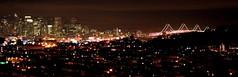 San Francisco Livin' (SaundraG) Tags: sf life sanfrancisco california city longexposure bridge topv111 skyline skyscraper canon 100v lights interestingness interesting v100 citylife 2006 best topv222 explore 200 baybridge 100views 100 200v top20night top20panoramas i500 saundrag