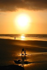 the sandcastle (Farl) Tags: sunset sea bali sun beach indonesia sand couple afternoon shadows play father son tip sandcastle sandscape technique aura kuta