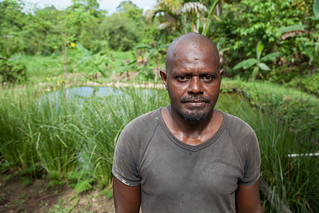 Marcus Rongodala stands in front of his tilapia pond, Rafrafu, Central Kwaraiae, Solomon Islands. Photo by Filip Milovac.