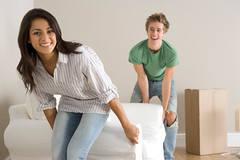 H.E.B Apartment Locators (1SourceApartments) Tags: woman man smile horizontal happy couple looking realestate flat adult box furniture packing room property happiness sofa cardboard together attractive newhome removal twopeople movinghome carrying lifting caucasian southasian atcamera