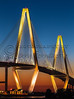 Arthur Ravenel Bridge at Sunset (Jerry Fornarotto) Tags: city longexposure travel bridge blue sunset sky orange sc water yellow vertical architecture modern night river landscape outdoors photography lights evening pier duck twilight arch waterfront suspension vibrant south mountpleasant scenic southcarolina engineering landmark structure architectural diamond architect cables photograph transportation cooper carolina upright iconic charlestonsc suspensionbridge span fishingpier cooperriver ravenel lowcountry cooperriverbridge ravenelbridge cablestaybridge patriotspoint royalblue newcooperriverbridge cablestay arthurravenelbridge diamondshape jerryfornarotto