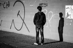 waiting with the shadow (alexhaeusler) Tags: blackwhite people street waiting intense lowsun shadow