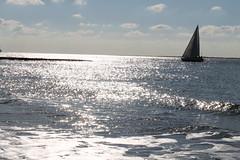 Blick auf´s Meer (ullameier) Tags: meer segelboot norderney wasser sonne glitzern endlos wolken sehnsucht