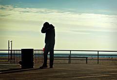 Blinded by the Light (Robert S. Photography) Tags: boardwalk man dog light sky cloud winter beach trashcan brooklyn brightonbeach coneyisland nyc nikon color coolpix l340 iso80 december 2016
