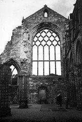 Abbey at Hollyrood Palace (Jae at Wits End) Tags: uk england blackandwhite bw white black building tourism church window monochrome architecture outside religious scotland blackwhite ancient ruins edinburgh exterior cathedral unitedkingdom outdoor decay religion ruin scottish landmark tourist structure worn weathered opening portal crumble spiritual attraction eroded