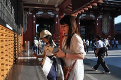 By the Senso-ji Temple (Thorsten Reiprich) Tags: city summer people urban travelling sunshine japan evening women asia day capital religion buddhism   tradition asakusa spiritual kanto  tokio honshu