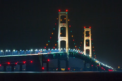 Night on the Straits of Mackinac (Kenneth Keifer) Tags: longexposure bridge blur water night wonder landscape lights evening rainbow twilight highway midwest colorful long suspension towers engineering landmark historic lakemichigan greatlakes transportation tall marvel carlights connection lakehuron mackinacbridge mackinac lighted mackinaw straitsofmackinac peninsulas upperpeninsulamichigan straitsofmackinaw