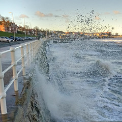 New Year splash [Explored 01-01-17] (Bon Espoir Photography) Tags: rhosonsea colwynbay northwales sea waves railings sunny winter splash buildings wales motog4