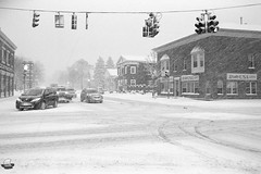 Film Photography: Winter at Four Corners, Orchard Park, NY (NFE_0063) (masinka) Tags: intersection film analog bw photography fourcorners orchardpark ny newyork snow winter snowfall snowstorm wny 716 traffic realtyusa white cold classic timeless timelessbuffalo etbtsy suburb buffalo 20a quaker st street rd road mood