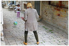 """Kicking the World around"" - Rovinj, Croatia (TravelsWithDan) Tags: motheranddaughter ball globe game kicking play oldtown narrowstreet candid streetphotography canon5d rovinj croatia"