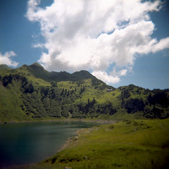 greatness of nature II (mathias-erhart) Tags: holga lech formarinsee landscape nature sky blue cloud clouds green mountain mountains tree trees hill hills lake water grass plant plants alpinehut film kodakportra400