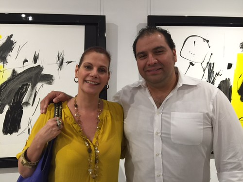 Mariana Azpurua, art editor for Venue magazine, with Hector Garcia at the Canale Diaz opening