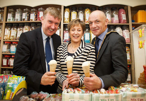 DSD Minister Mervyn Storey MLA enjoys an ice cream in the newly revitalised Kandy Store in Randalstown with shop owner Eileen Warwick and Deputy Mayor of Antrim & Newtownabbey John Blair