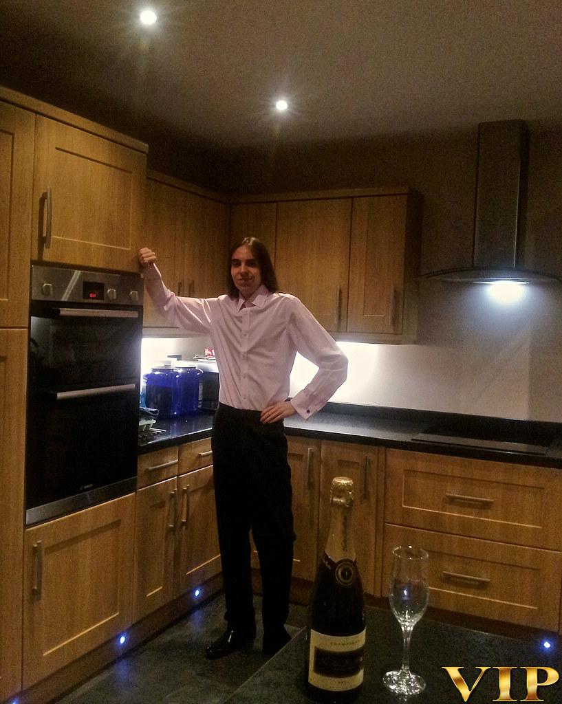 Pretty teen brunette kitchen posing