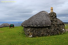Island life (Lord Skully) Tags: invernessshire trottenishpeninsula thatch thatchedroof cottage crofthouse victorian dwelling home coast coastal seaside seaview iinnerhebrides innerisles sea atlantic ocean traditional eileanacheò scotland scottish wildflowers buttercups outdoor outdoors conventional historic frankpickavant schottland skotland alba scozia scotia escocia ecosse britain britishisles uk unitedkingdom europe canoneos chimney stacks pot stone walls june 2016 spring springtime grass clouds sky rooftop landscape building architecture daytime roundcorners greenery singlestorey onefloor stonework bygonedays yesteryear past interestingplace history historical handcart pushcart cart barrow smokestack