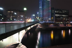 The loneliness of the night-time photographer (No_Mosquito) Tags: city night dark lights urban river bridge vienna austria wien europe water donaukanal buildings architecture nd 8 canon powershot g7x mark ii stacking modern aspernbrücke long exposure uniqa tower