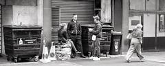 Wasting Time (Douguerreotype) Tags: uk gb british britain england london city urban bw blackandwhite mono monochrome people street four 4 bin trash rubbish waste friends conversation candid