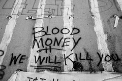 We Will Kill You Blood Money (Thomas Hawk) Tags: artdeco bloodmoney charlesnoble detroit leeplaza leeplazaapartments leeplazahotels michigan usa unitedstates unitedstatesofamerica abandoned bw graffiti fav10