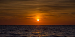 Smokey Sunset (christaff1010) Tags: uk sunset sea sky panorama sun sunlight wales clouds coast unitedkingdom britain ceredigion llangrannog