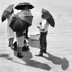 Waiting for the Grand Départ (d_t_vos) Tags: shadow people blackandwhite bw sun netherlands monochrome sunshine contrast umbrella square waiting utrecht shadows place zwartwit pavement nb parasol sw tourdefrance umbrellas schwarzweiss sunscreen parasols hotday jaarbeursplein noireetblanc granddépart dickvos dtvos