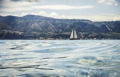 Sail boat (Rigby91) Tags: sea italy sun mountain water boat mare sailing view sunny sail sicily messina dinghy sunnyday maremontagna