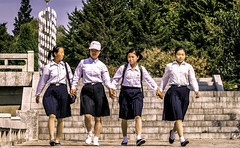 Hand In Hand (Baron Reznik) Tags: portrait girl horizontal kid child friendship streetphotography korea puto everydaylife northkorea sodo flatland pyongyang chosun changan dprk  colorimage  ryugyong     democraticpeoplesrepublicofkorea      canon1785mmf456is  chosnminjujuiinminkonghwaguk mansudaefountainpark kisong   ryugyng pyeongyangjikhalsi hwangsong rakrang sgyong hogyong capitolofwillows pyngyangchikhalsi