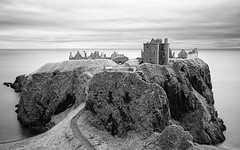 Dunnottar Castle (ShinyPhotoScotland) Tags: longexposure light sky blackandwhite panorama blur building castle art abandoned monochrome lines clouds landscape scotland sandstone aberdeenshire decay space places rules calm filter zen vista balance geology awe striking distance toned tranquil imposing cliche softlight headland lightanddark stonehaven elegance sidelit conglomerate hugin painteffects oldredsandstone rockstone nearfar digikam dunnottarcastle skyearth shapeandform spacefilling nd1000 naturehappens digitalred darktable photivo digitalbloom mankindnature digitalgradnd digitallowpass digitalc2g digitalgmic timefulness