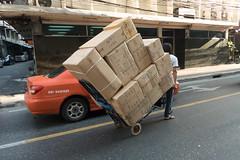 Traffic (ADMurr) Tags: bangkok thailand cart boxes orange car moving goods panasonic leica lens