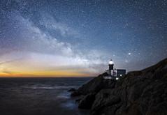 Lighting the way (Wojtek Piatek) Tags: dublin ireland wojtek stars astro photography photoshop composite sony alpha a99 zeiss landscape seascape night sea irish waves long exposure lighthouse