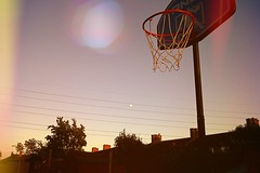Hoops. (NikkiNikNak1 ☾☀) Tags: orangesun yellow orange houses trees treees backyard lightrays goodvibes calm scene colourful rays lighting chillin summerevenings evenings moon sun hoops ball playingbasketball basketball bball shootinhoops