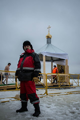 Rescuer provides security during Epiphany bathing in St.Petersburg (red line highway) Tags: epiphany bathing крещенские купания россия russia people january nikon winter tradition swimming ice cold water river fortress петропавловская крепость city life photojournalism socal documentary motion outdoor stpetersburg 2017 rescuer face